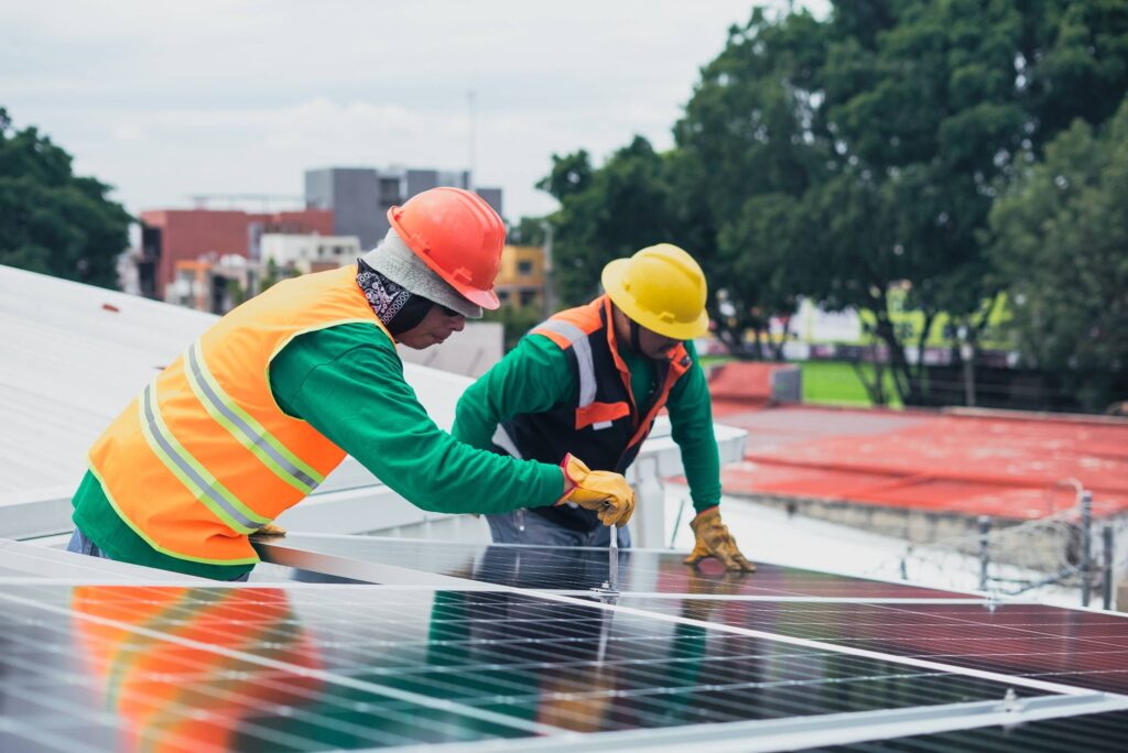 Picture is showing two men installing solar panels system